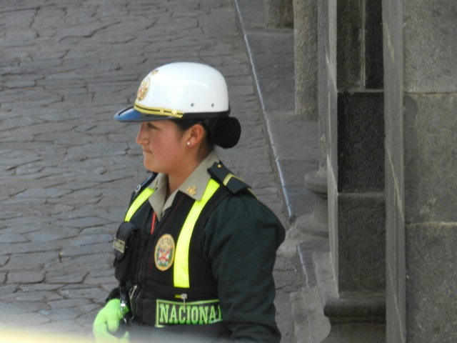 Peruvian Police are sharply dressed and serious.
