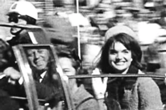 9-jackie-smiling-jfk-in-mirror